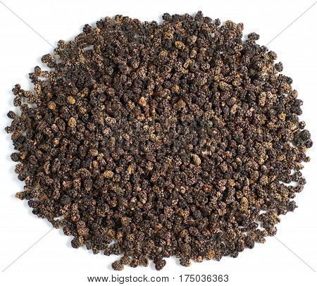 Heap of dried black mulberry isolated on white