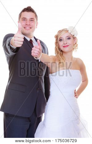 Positive relationship couples concept. Happy groom and bride posing for marriage photo waiting for the big day showing thumb up.