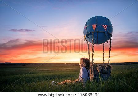 Little boy with a balloon outdoors
