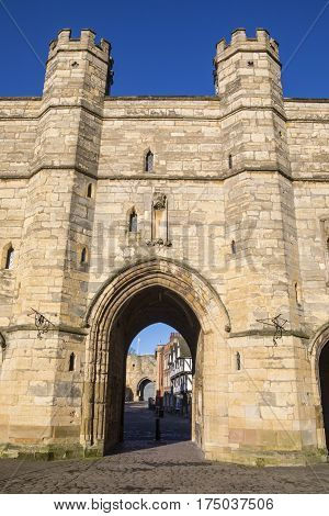 A view of Exchequer Gate in the historic city of Lincoln UK. Lincoln Castle can be seen through the archway.