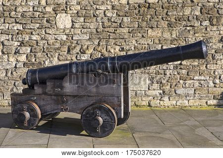 A cannon situated outside the historic Lincoln Castle in the city of Lincoln UK.