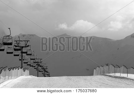 Black And White View On Snow Skiing Piste And Ropeway