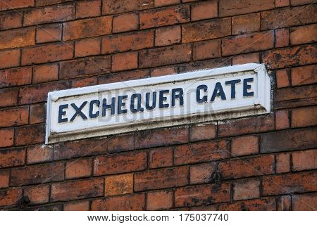 A street sign for Exchequer Gate in the historic city of Lincoln in the UK.