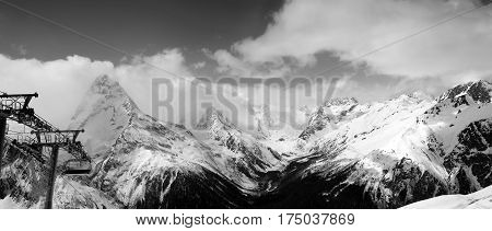 Black And White Panoramic View On Snow Mountains In Clouds