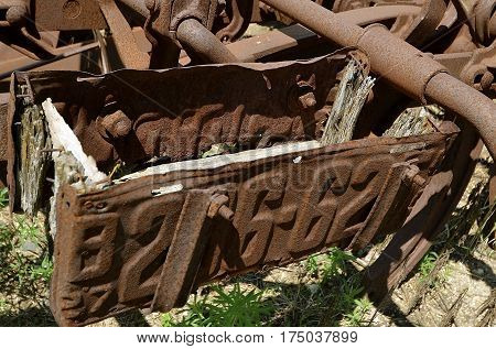 Rusty old license plates used to create a tool box on an old item of machinery