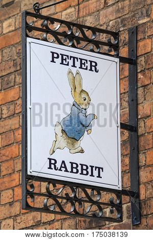 STRATFORD-UPON-AVON UK - MARCH 2ND 2017: A Peter Rabbit sign above a shop in the historic town of Stratford-Upon-Avon in the UK on 2nd March 2017.
