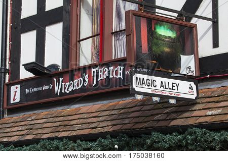 STRATFORD-UPON-AVON UK - MARCH 2ND 2017: The sign above The Enchanting World of Wizards Thatch and Magic Alley shop in Stratford-Upon-Avon on 2nd March 2017.