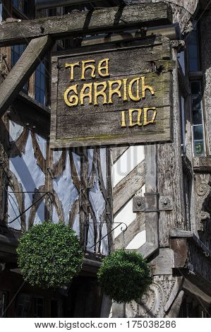 STRATFORD-UPON-AVON UK - MARCH 2ND 2017: The sign above the main entrance to the Garrick Inn Public House in Stratford-Upon-Avon on 2nd March 2017. It is reputedly the oldest pub in the town.