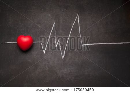 Cardiogram of heart beat on dark background with stethoscope. Concept of healthy lifestyle.
