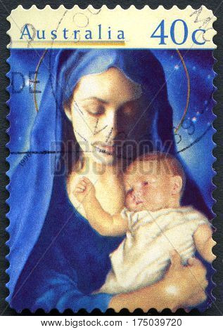 AUSTRALIA - CIRCA 1996: A used postage stamp from Australia depicting an illustration of Mary and the baby Jesus commemorating Christmas circa 1996.