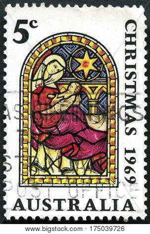 AUSTRALIA - CIRCA 1969: A used postage stamp from Australia depicting an illustration of Mary and the baby Jesus commemorating Christmas circa 1969.