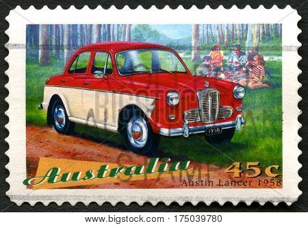 AUSTRALIA - CIRCA 1997: A used postage stamp from Australia depicting an illustration of an Austin Lancer 1958 automobile circa 1997.