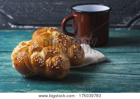 Wheat Buns With Sesame Seeds On A Dark Wooden Background