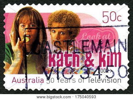 AUSTRALIA - CIRCA 2002: A used postage stamp from Australia celebrating the comedy television series Kath and Kim circa 2002.