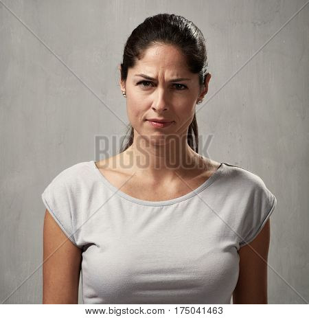 Young woman looking camera incomprehension face expression
