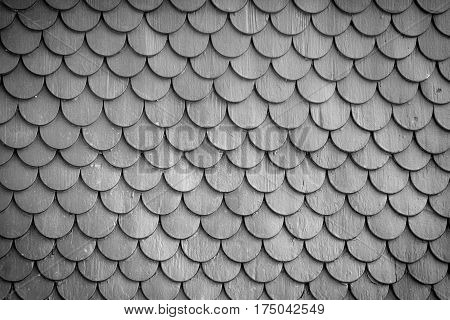 Old rustic wood tiling roof wall texture background. Traditional protection for roof and facade.
