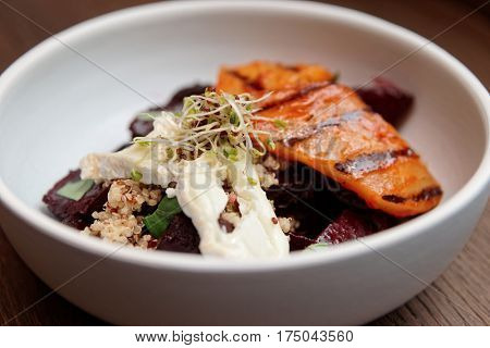 Appetizer of baked beetroot and grilled pear in porcelain plate
