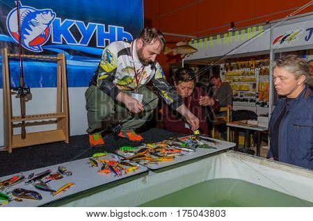 Moscow, Russia - February 25, 2017: Professional fisherman advertises wobblers and tackles on the special exhibition in Russia, VDNKh