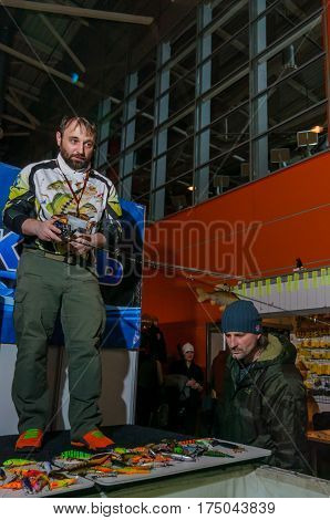 Moscow, Russia - February 25, 2017: Professional fisherman makes a presentation wobblers and tackles on the special fishing show in Russia, VDNKh