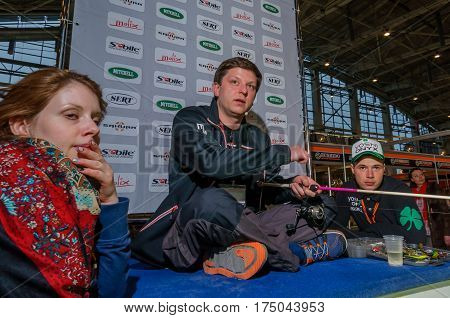 Moscow, Russia - February 25, 2017: Professional fisherman conducts presentation of wobblers and fishing gear on the special exhibition in Russia, VDNKh