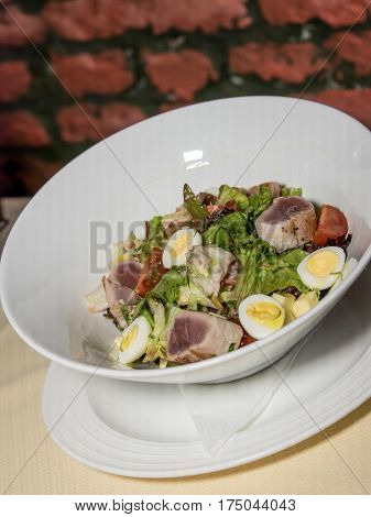 Salad with eggs tuna anchovy lettuce and olives