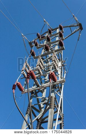 Distribution of electrical energy. Columns high voltage power lines. Production of energy