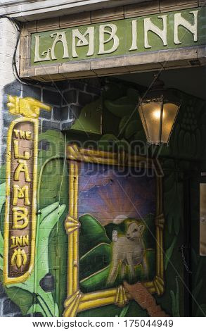 NORWICH UK - JANUARY 17TH 2017: A view of the entrance to an alleyway that leads to the Lamb Inn public house in the historic city of Norwich on 17th January 2017.