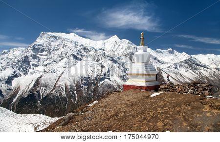 Panoramic view of Annapurna 2 II 3 III 4 IV Ganggapurna and Khangsar Kang Annapurna range with stupa way to Thorung La pass round Annapurna circuit trekking trail Nepal