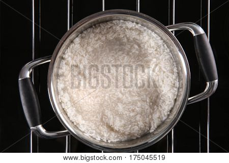 Rice in metal pan on hotplate