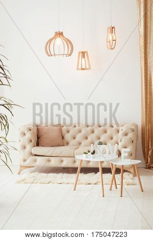 Interior living room with a sofa, table, floor lamp and panoramic window. Beautiful Living room Architecture Stock Images, Photos of Living room. Interior photography.