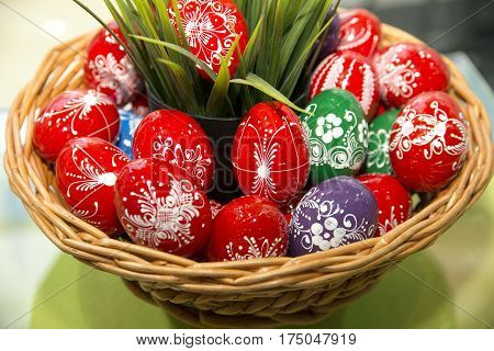 Budapest Hungary - March. 2. 2017: Handmade colorful easter eggs basket as easter present at Travel Show Budapest 2017. Easter egg basket filled with a colorful handmade variety of eggs
