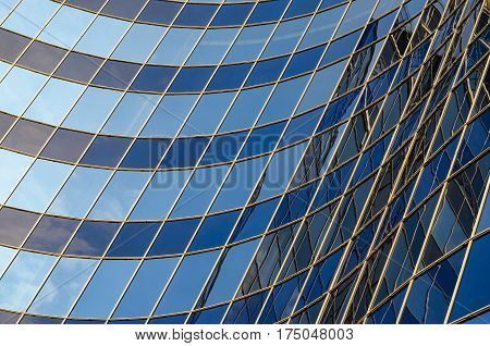 Curved glass facade of modern building. Abstract background