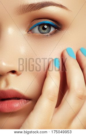 Beautiful Young Woman With Trendy Blue Makeup. Beauty Concept