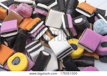 Background image of an assortment of licorice candy sweets