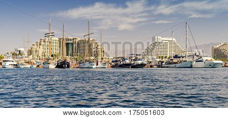 Central public beach and marina with pleasure boats and sailboats in Eilat - famous resort and tourist city in Israel