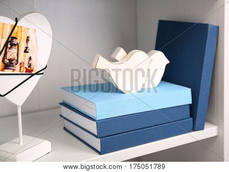 White wooden shelving with books