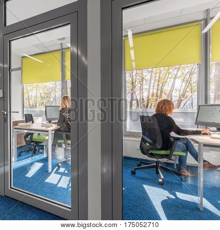 Modern and light office interior with glass door