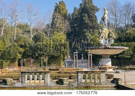 FLORENCE, ITALY - February 02, 2017: fountain Ocean by Giambologna (sculpture of Neptune surrounded by water deities) in Boboli Gardens, Florence, Italy