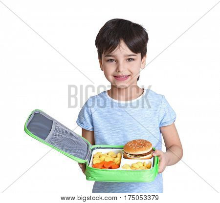Cute little boy with lunchbox on white background