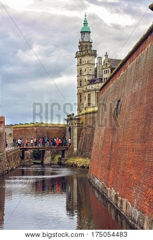 HELSINGOR DENMARK 14 JUNE: tourist group enter the Kronborg castle where William Shakespeare based his Hamlet drama novel in 2012