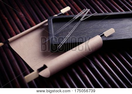 Set of needles for acupuncture on bamboo mat poster