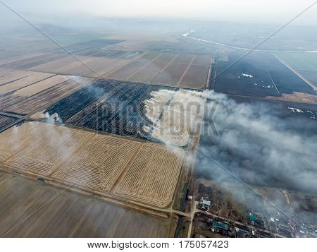 Burning Straw In The Fields