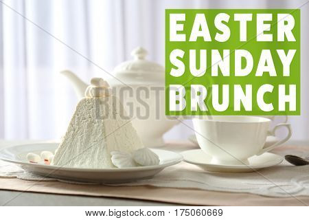 Text EASTER SUNDAY BRUNCH on background. Plate with traditional curd cake on table