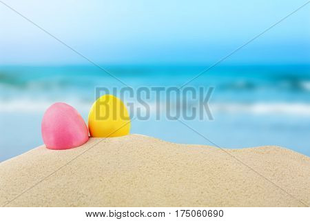 Easter eggs on sand at sea shore