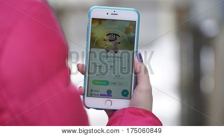 Samara, Russia - March 7, 2017: woman playing pokemon go on his iphone 6s Plus. pokemon go multiplayer game with elements of augmented reality. Miltank was caught. Second generation of Pokemon