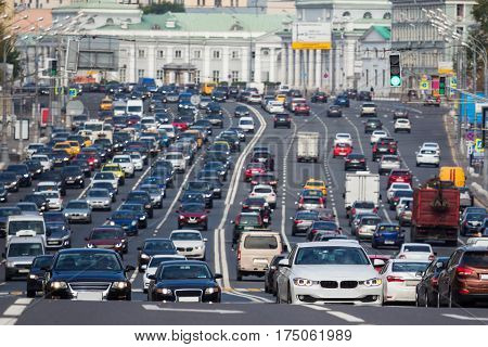 View from above to the heavy traffic on the city highway