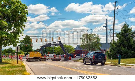 TWINSBURG OH - JULY 10 2016: An SUV whose driver had ignored earlier warning signs finds its way blocked by construction of a new roundabout.