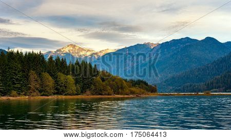 Mount Blum glows in setting sunlight above Baker Lake in Washington's North Cascades