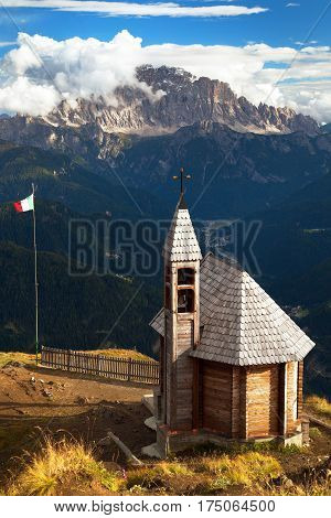 Small wooden church or chapel on the mountain top Col di Lana and Mount Civetta Alps Dolomites mountains Italy