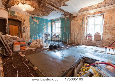 Interior of apartment with materials during on the renovation and construction ( making floor from cement)